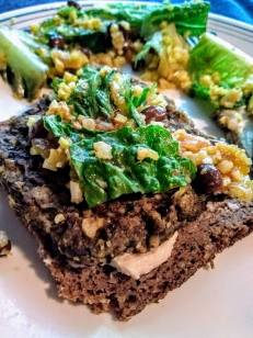 old world pumpernickel bread is good to keep on hand. Topped with homemade bean burger from freezer