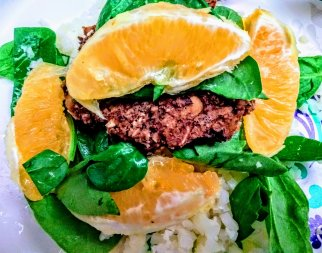 Black Bean Chick Pea Salsa Burger w/ lemon spinach and Orange Sections