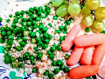 Frozen brown rice and a bag of frozen peas tossed together with light seasoning. Some raw carrots and a few grapes. No fuss meal